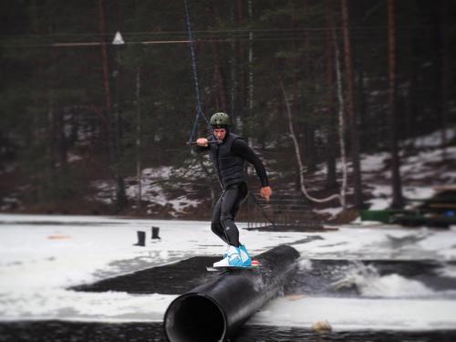 Ice wakeboarding jibbing